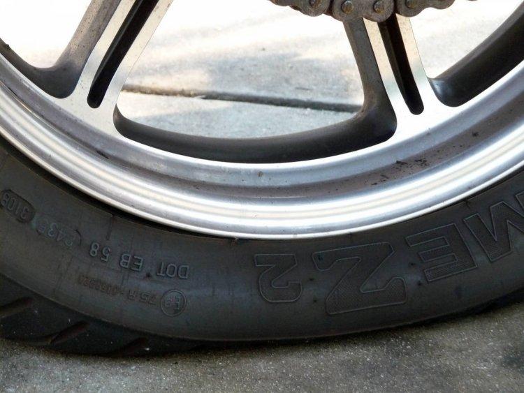 motorcycle-flat-tyre-puncture.jpg