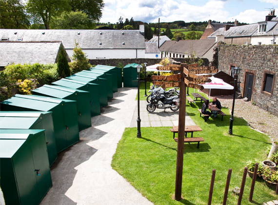 Rear Garden with Motorcycle Garages and Hard-standing area