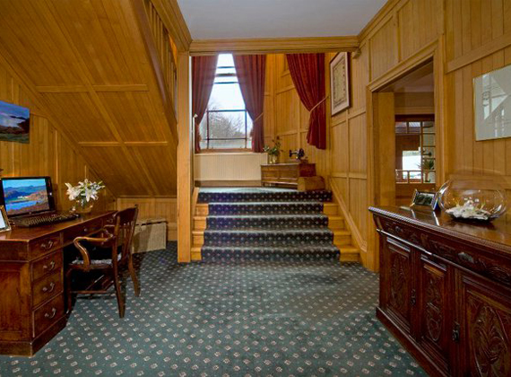 Lobby with staircase up to main house rooms and computer for guest access to the internet