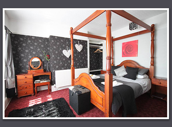 Double Four Poster Bedroom